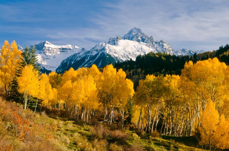 While fall colors only stick around for a shorter period of time in Colorado, this mountain valley community's views of snowy peaks next to brightly colored trees can only be described as picturesque.  For more information, visit Ridgwaycolorado.com.   - CountryLiving.com