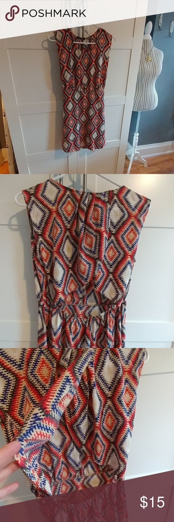 Beautiful open back dress This dress is perfect for vacation! Light weight and transitional! No wrinkle too! Back is pleated at nape of neck and falls open to reveal the small of your back. Elstic to hold it in place at your waist. Size small. Dresses Mini