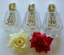 3 Lourdes Water Bottles with Rose Tops.