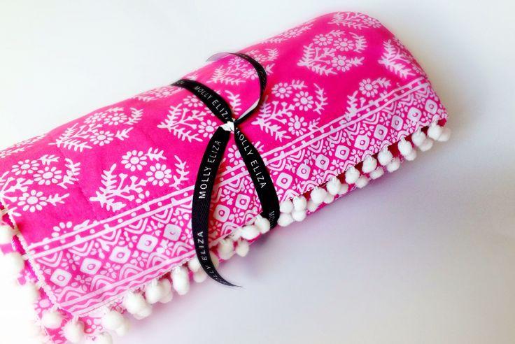 Pretty pink pom pom boho beach blanket. Summer lovin' by Molly & Eliza Take a glimpse of the adventures of  Molly & Eliza on Instagram - #mollyandeliza
