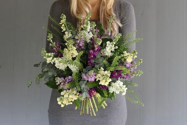 A luscious mix of fragrant stocks with simple green bell foliage.