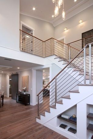 Contemporary Staircase with High ceiling, Crown molding, Modern Interior Railing, Hardwood floors, Metal staircase