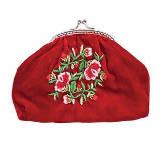 This very cute coin purse is enhanced by the feminine Beaded Flower design. This design is based on one of Tamsin's signature embroideries that she has reintroduced for the winter season. Delicately, hand stitched pink and red flowers on sumptuous velvet are topped off with a darling vintage style clip closing.