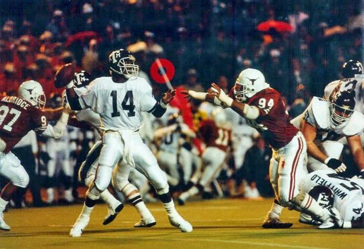 DE Thomas Aldridge# 97 & DT Brian Espinosa # 94 of Texas v QB Kevin Murray of A&M in1986.