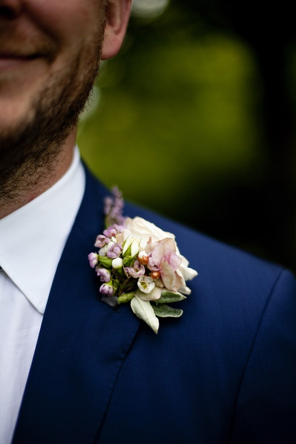 navy blue suit, but must change the flower!