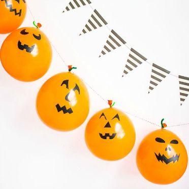 Turn balloons into jack-o-lanterns