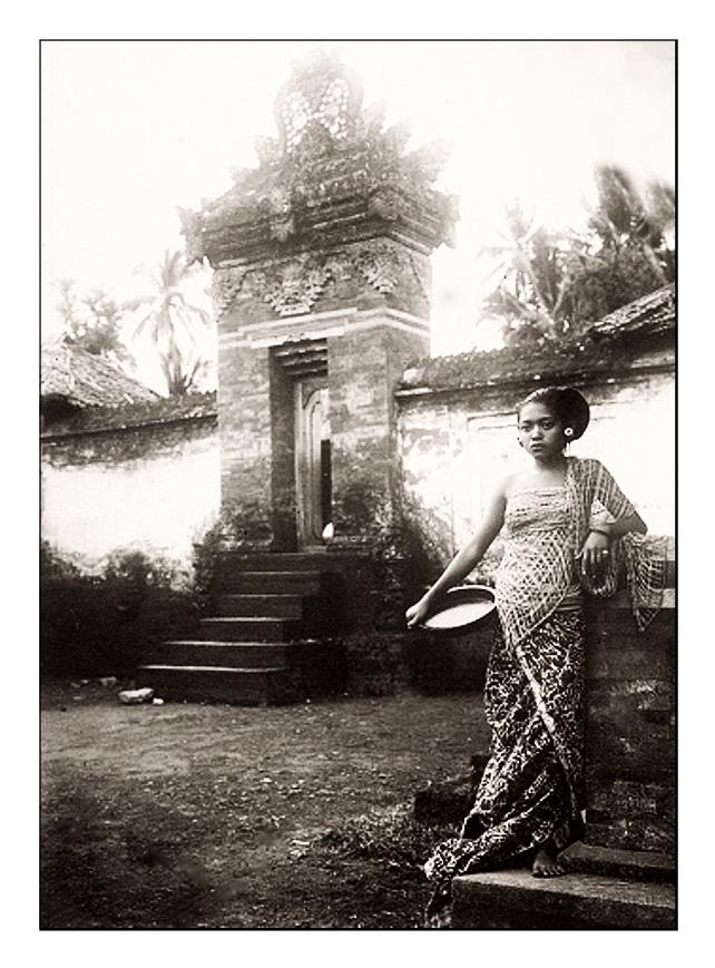 Balinese woman with cup, date and photographer unknown.