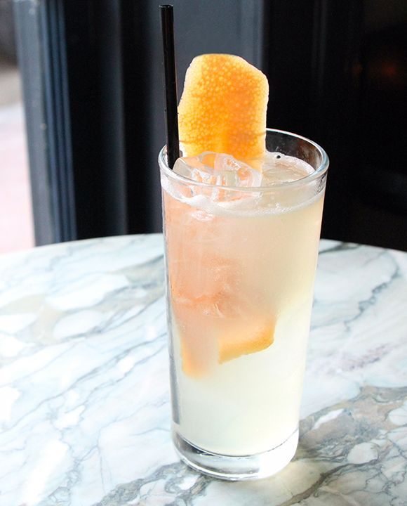 SEAWORTHY'S GOLDFINCH: 1 oz. Cocchi Americano 1 oz. fino sherry ¾ oz. fresh lemon juice ½ oz.simple syrup(1:1) 2 dashes orange bitters Tools: shaker, strainer Glass: collins Garnish: grapefruitpeel  Shake all the ingredients with a single ice cube. Strain over fresh ice into a chilled glass. Top with club soda and garnish.