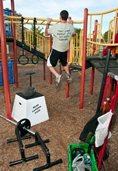 West Lansing Pack, a group of neighbors who get together at night to CrossFit at the local school playground. They make their own equipment and roll it to the school on dollies.