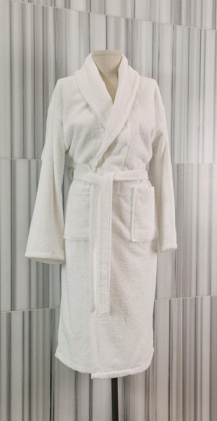 Made from 100% pure Turkish cotton, our Shawl Terry robes are loomed to a 340 gsm weight.  With a casual, laid-back fit, these robes offer superior softness and absorbency. The design features a shawl collar with two patch pockets and is finished with a two-looped belt for easier fitting.  - See more at: http://www.talesma.com/eng/95/talesma--shawl-terry-robe.html#sthash.3g37yChJ.dpuf