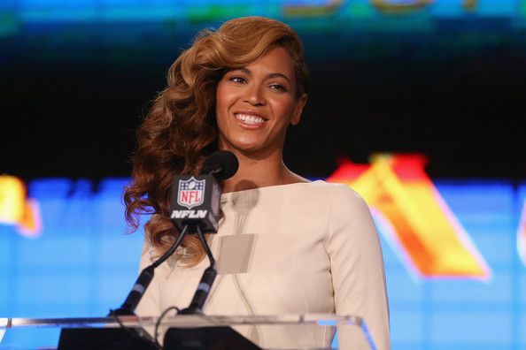 Beyonce Knowles Photos Photos - Beyonce performs the National Anthem at the Pepsi Super Bowl XLVII Halftime Show Press Conference at the Ernest N. Morial Convention Center on January 31, 2013 in New Orleans, Louisiana. - Pepsi Super Bowl XLVII Halftime Show Press Conference
