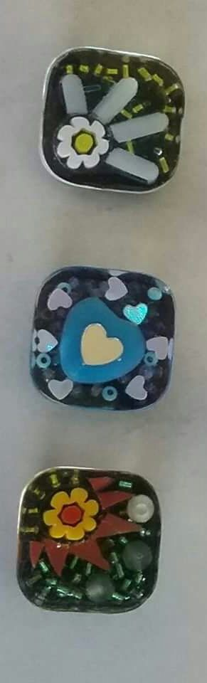 Resin mosaic rings.