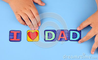 I love dad spell out on blue background with child's hands. Letters drawn by me.
