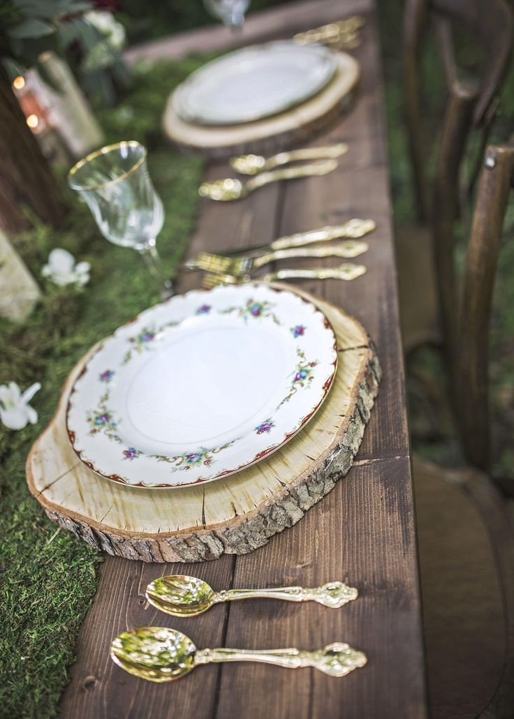 Moss table runner, vintage floral plates, gold utensils, tree bark chargers, woodland fairytale // Ashley Sanchez Photography