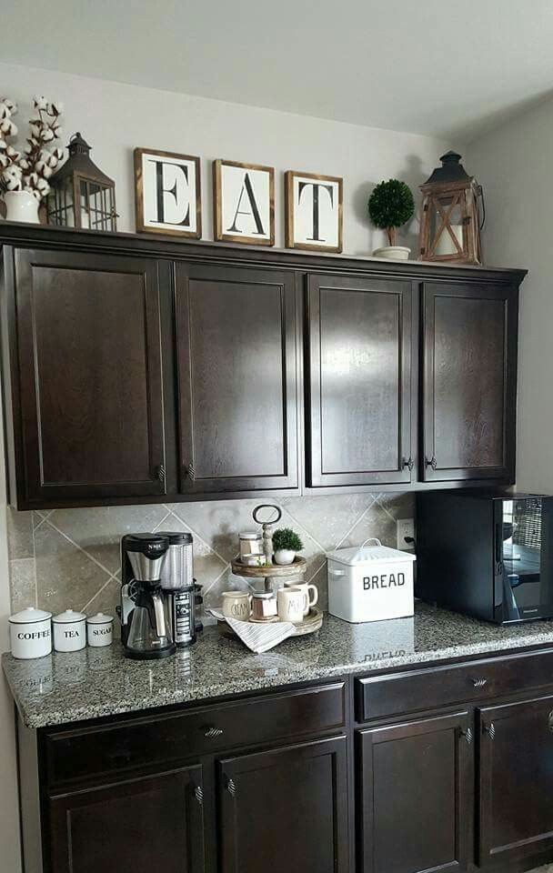 Dark Kitchen Light Decor In 2020 Decorating Above Kitchen Cabinets Kitchen Cabinets Decor Rustic Kitchen Decor
