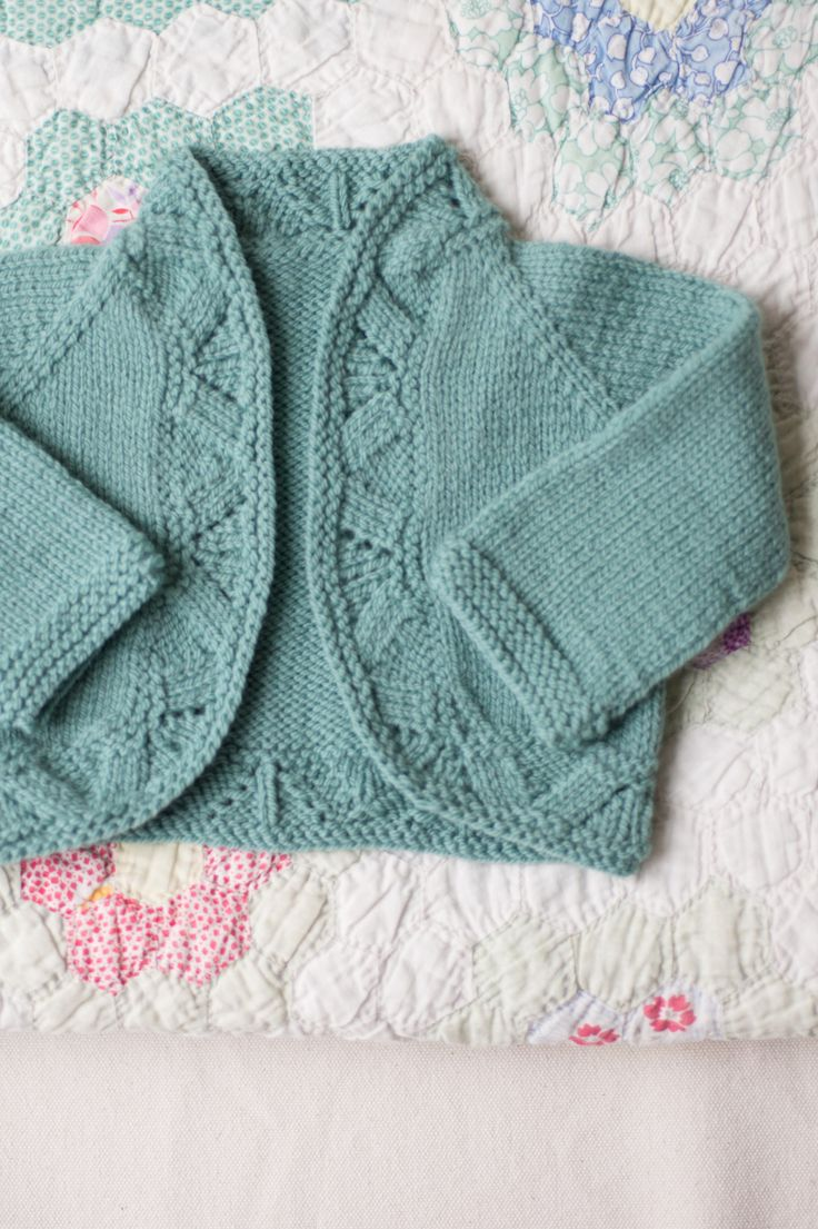 mae baby to toddler cardigan. Knit in one piece. Very cute.