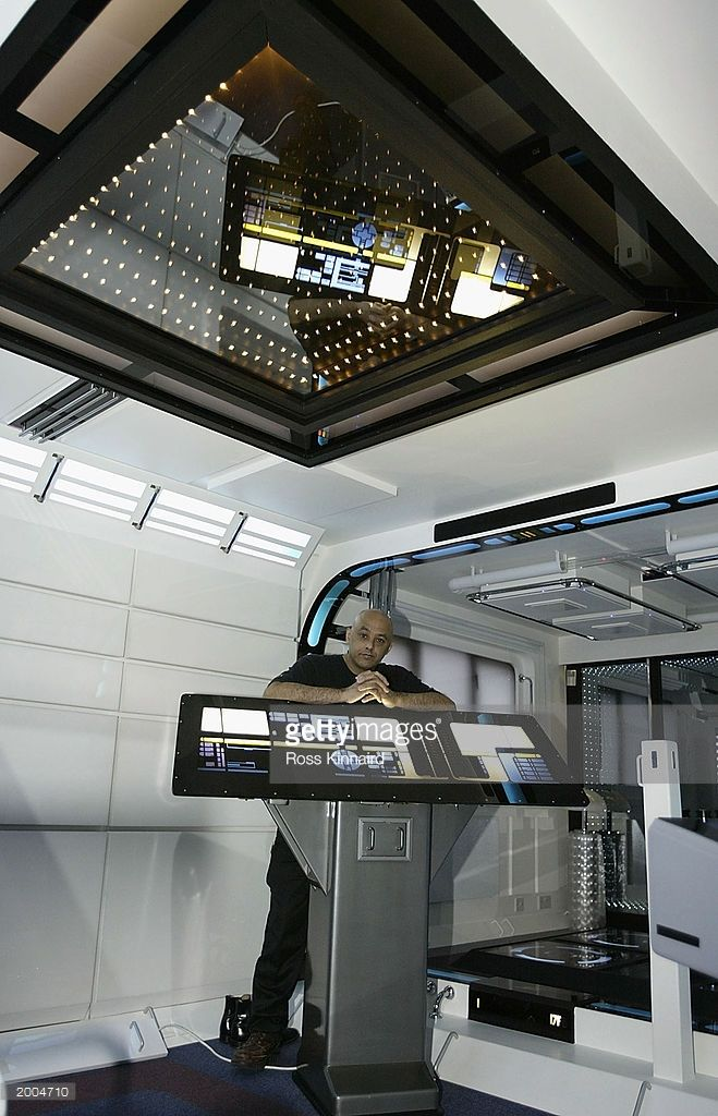 Interior designer Tony Alleyne stands in his 'Star Trek' theme studio apartment May 16, 2003 in Hinckley, Leicestershire, England. The apartment took nearly 10 years to redesign in the style of the 'Star Trek' Starship Enterprise and is now on sale for approximately US$1.7 million.