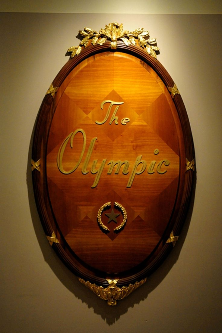 entrance of olympic restaurant, aboard of the gtb millennium celebrity