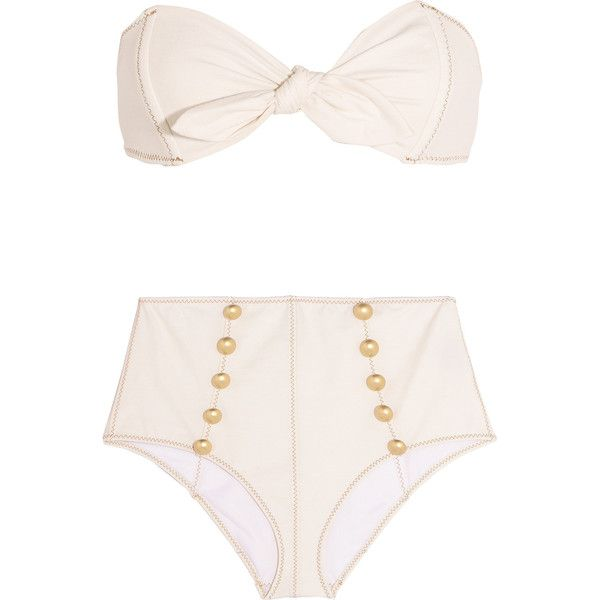Lisa Marie Fernandez's best-selling 'Poppy' bikini is inspired by styles worn by Brigitte Bardot in the '60s. This cream stretch-denim set has a knotted bandea…