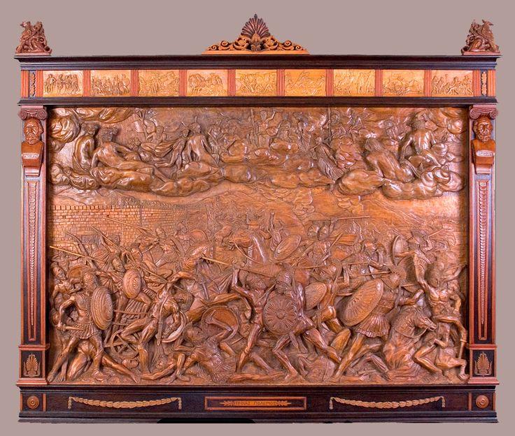 "J. M. Félix Magdalena.-  ""TROYAS POLEMOS"" Talla en altorrelieve sobre madera de arce,184 x 162 x 12 cm."