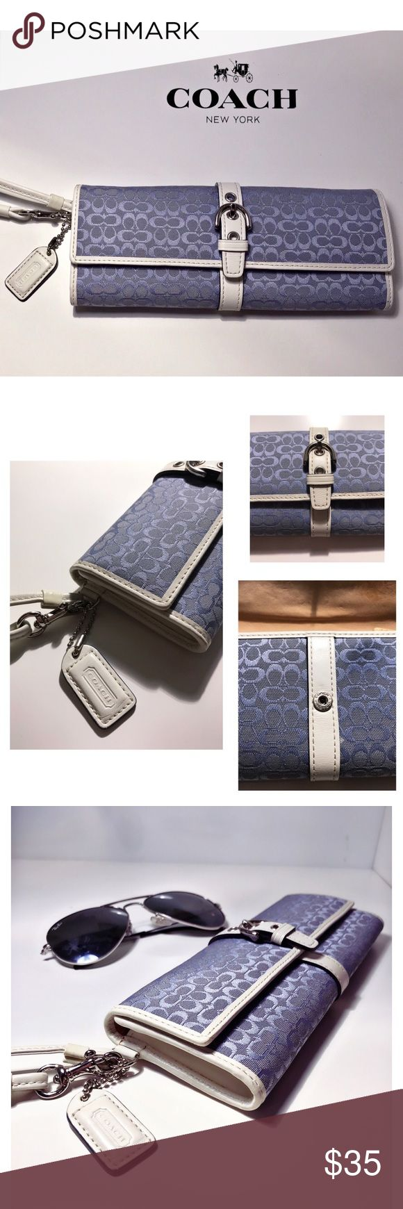 ⚡️COACH Signature C Blue and White Long Wristlet A little different than a typical Wristlet! 💁🏻♀️ It has the Signature jacquard fabric in baby blue, with white leather trim & strap. It has silver hardware & snap button closure. Inside it is light tan leather with brown lining. It has a zipper pocket & 2 regular pockets. It can carry your most important essentials! In the 4th photo you'll see there's a light pen mark, so as a BONUS I'll throw in a Coach coin purse! 😃 It's tan with silver…