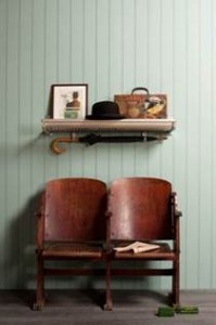Luggage racks as shelves from the London Museum of Transport. Love the vintage cinema chairs too