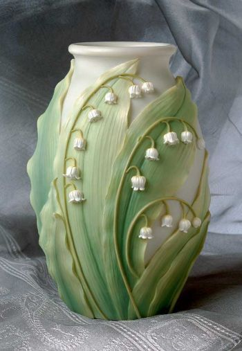 """The vases are cast in high quality bonded marble and delicately hand painted. Each is waterproof for flower display. Approximately 5""""w x 8""""h."""