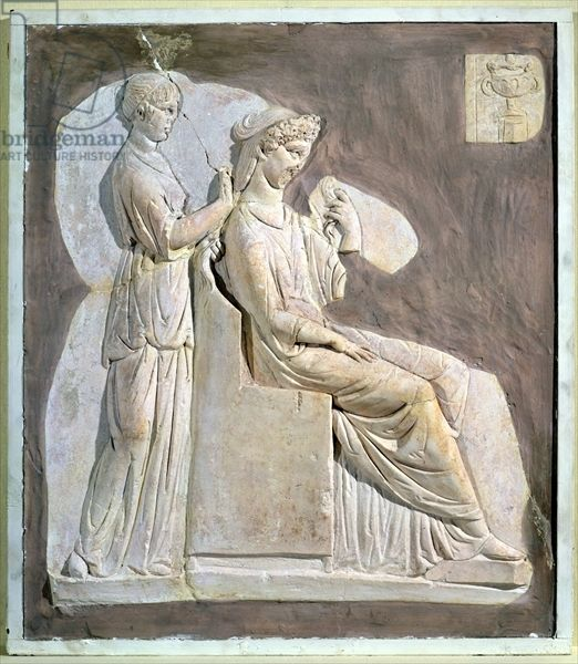 Relief depicting a woman at her toilet, from Tunisia (stucco). Roman, (2nd century AD) / Musee National de Carthage, Carthage, Tunisia / Giraudon / The Bridgeman Art Library