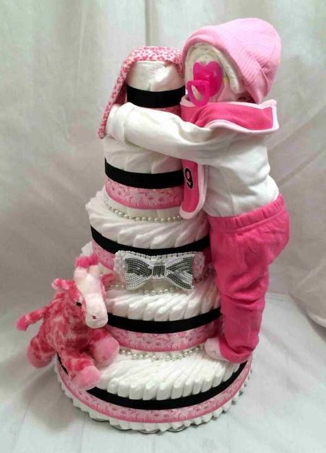Standing diaper baby girl diaper cake centerpiec! Go to chicbabycakes.com to request your custom diaper cake.
