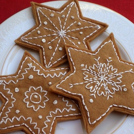 Embroidered Felt Gingerbread stars - would be great homemade gifts, add a loop for the tree!