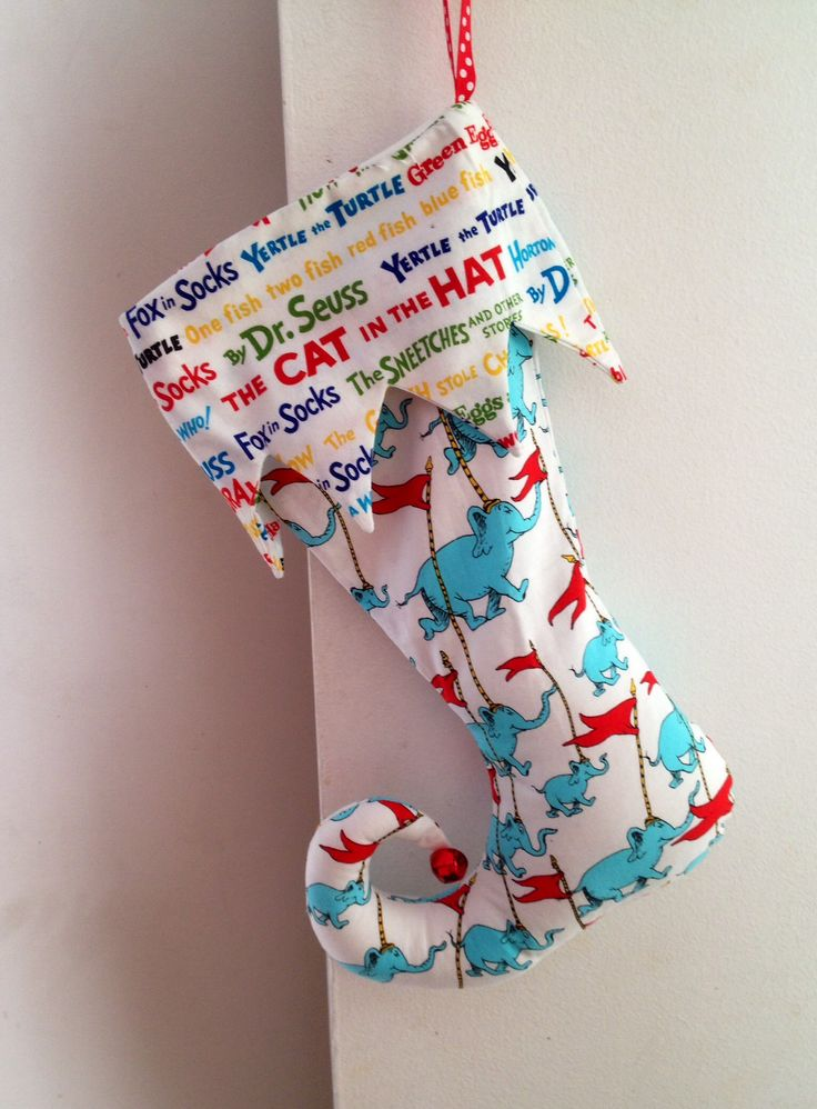 Gorgeous lined elf stocking, holds a box of favourites chocolates.