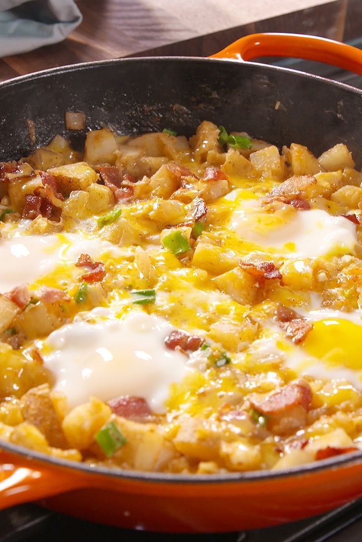 Loaded Breakfast Skillet  -  potatoes, bacon, onion, garlic, green onions, eggs, cheese, paprika, spices, etc.  easy, somewhat frugal and balanced, sounds good, want!     lj