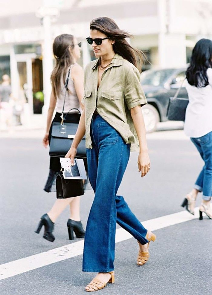 Flare jeans with a cargo shirt and low heels.