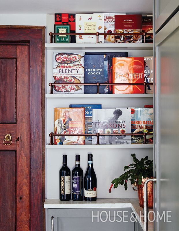 If you're an avid cook or just enjoy collecting cookbooks, a showcase of books is an easy way to fill an awkward corner where cabinets wouldn't fit. | Photographer: Stacey Brandford | Designer: Sarah Richardson Design