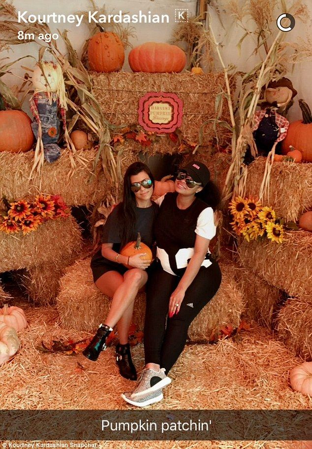 'Pumpkin patchin'': The ladies posed for a snapshot alongside one another among bales of hay in a Snapchat photo Kourtney posted