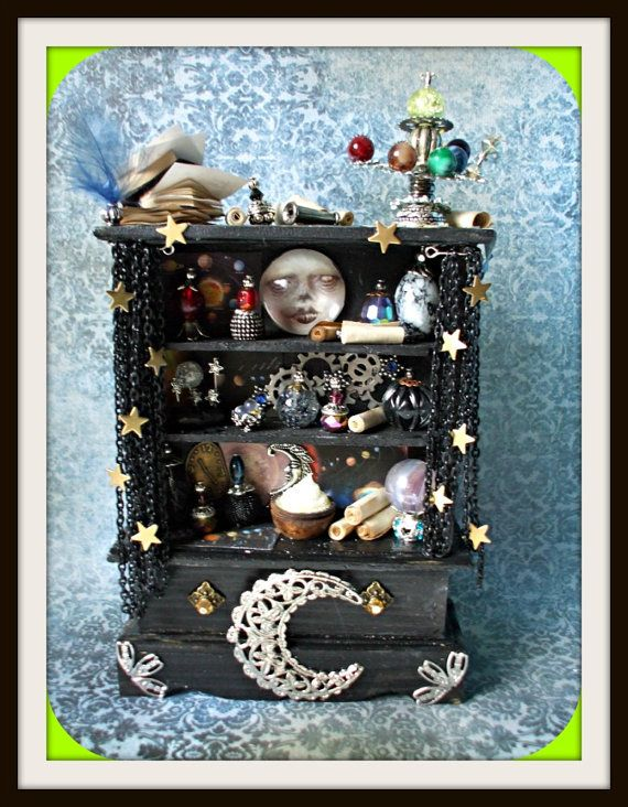 really like the idea of using an old large jewelry hutch as a halloween diorama - Halloween Diorama Ideas