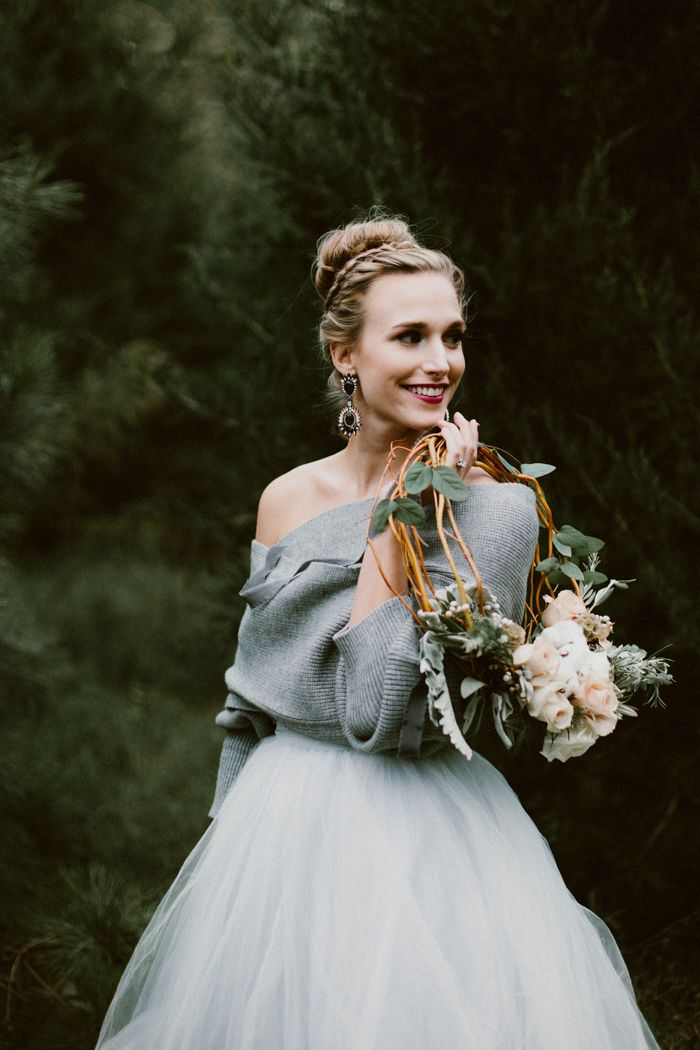 This cozy winter wedding shoot features a muted, icy color palette, super soft textures, and an absolutely dreamy floral bridal wreath.