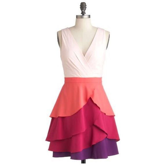 "Minuet Color Wave Dress  This tiered dress will clothe you in style of vibrant, colorful hues. The fluttering fabric is silky, and has fully lined frock, a surplice neckline and a tiered layered skirt of coral, raspberry, and grape tones. Shell: 96% Polyester, 4% Spandex. Lining: 100% Polyester. Hidden side zipper with hook & eye closure. 34"" in length. Excellent condition, like new!Perfect for any summer event, nigh or day, and a unique, flowy look! Minuet dba Audrea, Inc. Dresses"