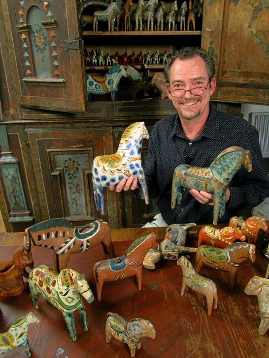 Staffan Haegermark collector of Swedish Dala horses. The horses in the picture are from the 19th and the 20th century and from Bergkarlås, Risa, Vattnäs och Nusnäs.