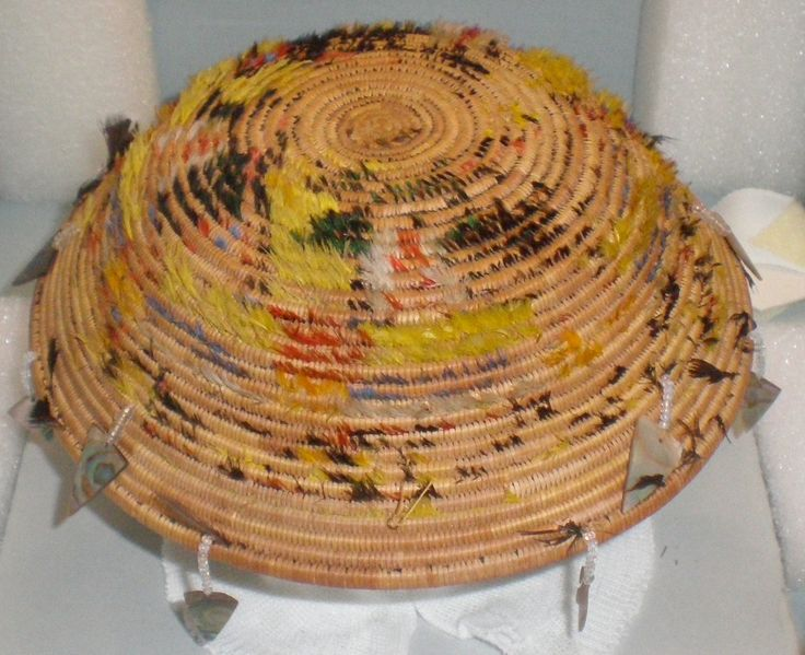 Another historic basket embellished with feathers, shells and glass beads. The collection was conserved by Spicer Art Conservation. Courtesy of the Dept. of the Interior.