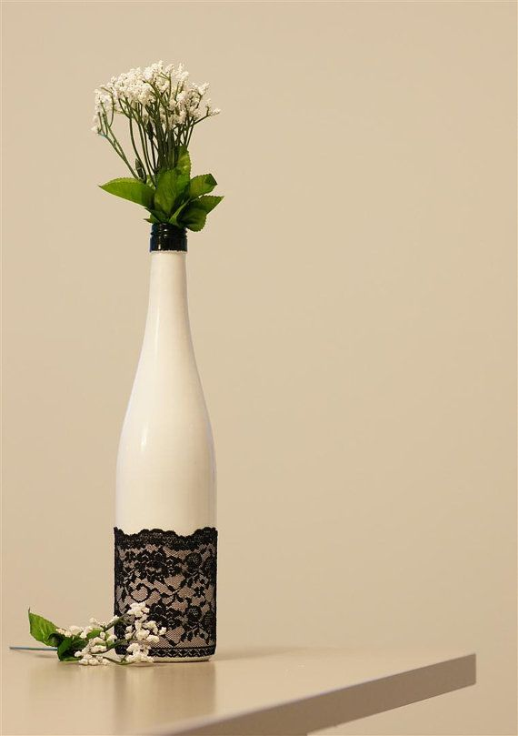 Ooh la la, painted and lace wrapped wine bottle turned into a vase
