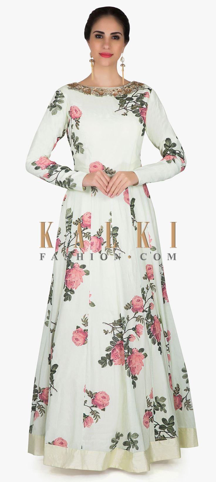 Anarkali gown in powder green silk adorn in print and zari embroidery only on Kalk