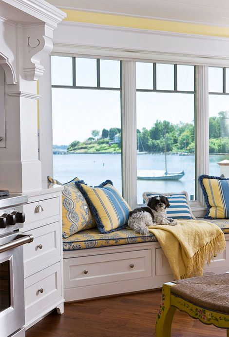 Pale-yellow walls frame a window seat where the kids can relax and talk to Cheryl while meals are prepared. Jillian the Shih Tzu obviously finds it a fine spot, too.