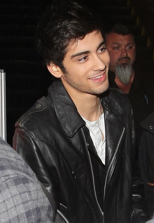 Zayn looks cute. Then the guy with the beard looks a little creepy..... lol