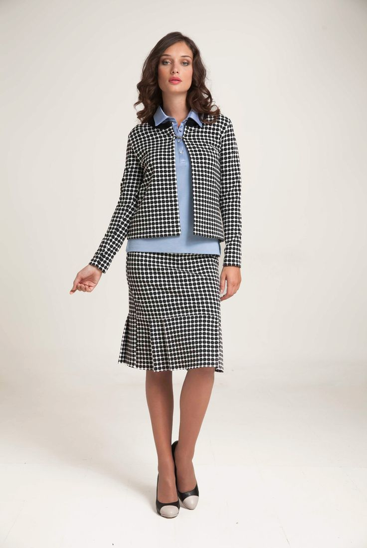 Knitted check jacquard cardigan with round neck and long sleeves. Black edgings at neckline. Fastening with two silver hooks. Combine with  jacquard skirt or black trousers according to your occasion. http://www.alexanderjacob.com/en/cardigans-bolero/146-check-jacquard-cardigan.html