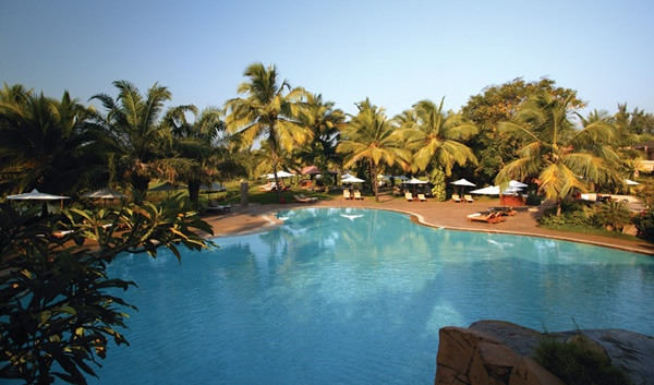 view from the waterfall above one of the pools at the leela kempinski hotel and resort in południowe, goa.