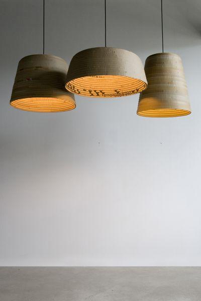 Recycled cardboard pendants.