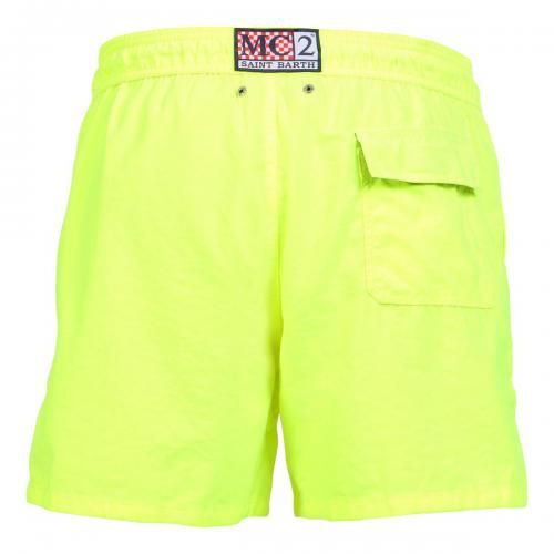 """FLUORESCENT YELLOW POLYESTER SWIM SHORTS WITH SKULL PATTERN - Fluorescent yellow solid color polyester Long Swim Shorts featuring a skull and """"PIRATES DE SAINT BARTH"""" writing at lateral side. Two front pockets and back Velcro pocket. Internal net. Elastic waistband with adjustable drawstring.  #mrbeachwear #mc2 #boardshort #fashion #man #summer #style"""