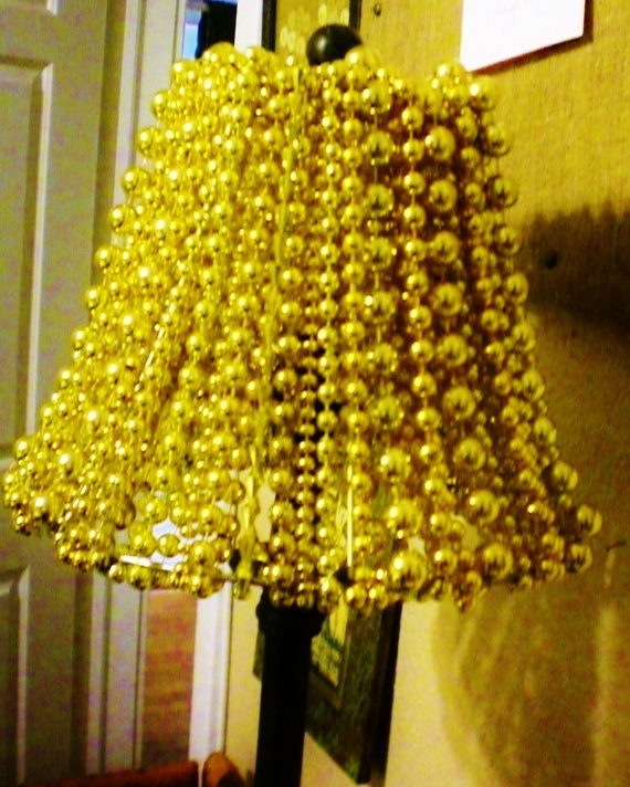 Gold Mardi Gras Bead Lamp Shade by nolabeadart on Etsy *Take the cheap beads from the Dollar Tree, spray paint them white or silver, and this could be a cute craft!