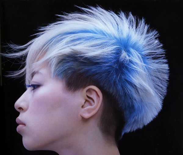 I like how the roots are blue but the hair is white...like bleaching, but backwards. Awesome haircut, too.